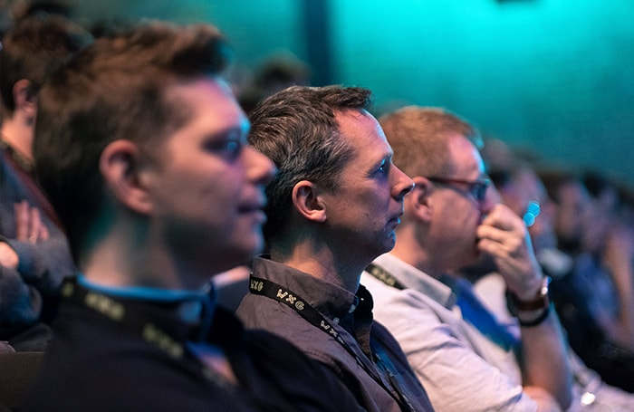 A WXG audience listening to a talk